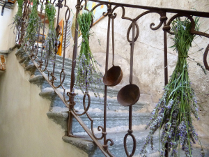 fresh lavender hanging on the stone staircase railing with ladles antichibed and breakfast Contrada long abbadia lariana LakeComo
